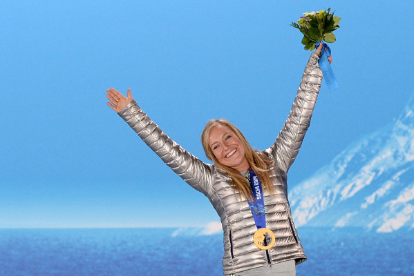 A picture taken with a robotic camera shows US gold medalist Jamie Anderson posing on the podium during the Women's Snowboard Slopestyle Medal Ceremony at the Sochi medals plaza during the Sochi Winter Olympics on February 9, 2014.   AFP PHOTO / ANTONIN THUILLIER        (Photo credit should read ANTONIN THUILLIER/AFP/Getty Images)